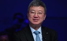 朱民:全球经济企稳 金融风险犹存